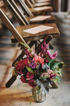 Mercury jars sprouting fresh ferns and flowers in shades of marsala add a rustic glam touch.