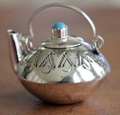 Navajo Indian Turquoise Tea Pot @ by Leslie Whiteman. This is a TINY, pendant teapot. Imagine the work that went into this.