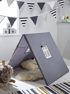 Create a sweet hideout for your little one with our petite, Scandinavian inspired A frame tent. Equally perfect for imagination games and quiet time with book, it will transform their room into a magical place Made from wood with a grey cotton canvas cover, it has a little window to let in the light.