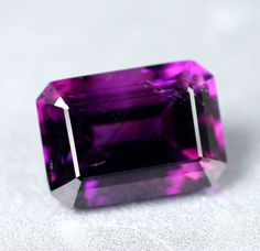 Amethyst - Jalingo, Nigeria  Finest Siberian color possible. a few tiny hematite threads as inclusions, this stone is rare and almost irreplaceable. One of the finest amethyst we have ever cut.
