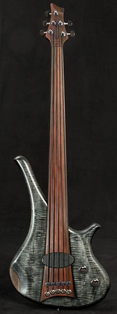 """Marleaux Bass with gray spackled body and fretless neck - long pointed horn gives this a special edge.. pun intended :) RESEARCH by DdO:) - http://www.pinterest.com/DianaDeeOsborne/instruments-for-joy/ - This German company hand builds custom basses. This model is the DIVA with an avant-garde shape that includes a three octave fretboard. Customers can choose their wood. DIVA won """" Best Bass Award at Namm 2014"""" at the Nammshow in Anaheim, California USA."""