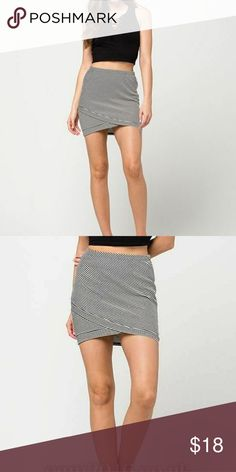 """Ribbed Striped Wrap Skirt All-over striped design with stretchy ribbing. Elasticized waist. Approx length 16"""". 48% polyester, 47% rayon. 4% spandex. Full Tilt Skirts Mini"""