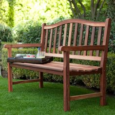 Turn any space in your yard into your own secret garden with this 4-Ft Wood Garden Bench with Curved Arched Back and Armrests. Made from tropical hardwood, the bench can survive years of exposure to e