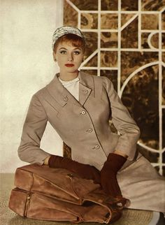 Wearing a flannel suit by Harry Frechtel, with a flowered turban by Adolfo of Emme, photo by Louise Dahl-Wolfe. thanks to Sophia :)