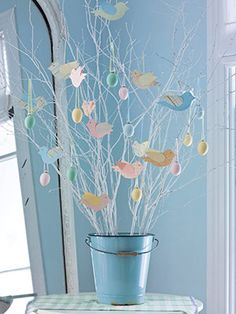 Tabletop spring tree! Decorate with paper birds and blown eggs. More spring decorating ideas: http://www.midwestliving.com/homes/entertaining/spring-centerpieces/
