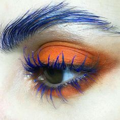 orange smoky eyeshadow with blue mascara and blue eyebrows #makeup #editorial #catwalk