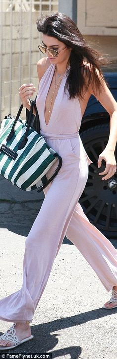 Not-so casual: The BFF of Gigi Hadid cloaked her svelte frame in a sleeveless deep V-neckline halter top and wide-leg trousers