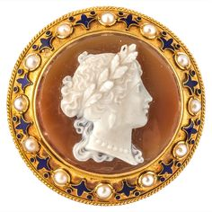 Hardstone Agate Cameo Gold Brooch. Hardstone Agate cameo Brooch of a female profile with enamel and Pearl border set in 15t Gold with original fitted case. Circa 1875