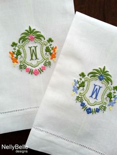 Monogrammed guest towel. Monogram embroidered in your choice of colors on linen/cotton guest towel with pulled thread hem.Shown in pink and orange and in blues.  NellyBelle designs