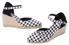 HERMENIA espadrilles from www.espadrillesetc.com  Checking in or checking out HERMENIA does it with polished panache