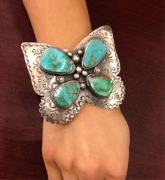 """Lot 315 in the 10.15.13 online & live auction! Beautiful & large sterling silver 5 banded cuff bracelet with Southwestern style design. Bracelet have lovely butterfly shape. Featuring 4 pear cut, natural blue Gem turquoise stones. Gemstones are bordered with pressed repousse designs. Marked """"Sterling"""" measures: 7.25"""" around with 1.25"""" opening x 3"""" wide. Total weight: 2.79 ozt. #Jewelry #Fashion #Clothing #Shopping #POGAuctions"""