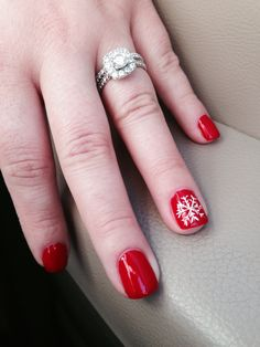 Classic red manicure with a snowflake for Christmas :]