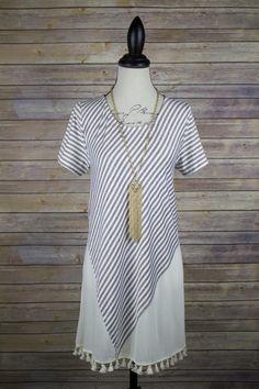 Striped tunic with tassel bottom.