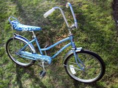 I owned a banana seat bicycle similar in color to this.  Mine had clouds on the seat.