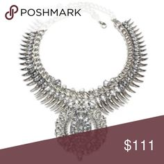 NEW ARRIVAL Edgy Chic Crystal Statement Necklace NEW ARRIVAL Edgy Chic Crystal Statement Necklace~~ Showcasing an array of chain-linked details, glistening crystals, this Edgy Chic neckpiece guarantees a statement from day to eve. Dina Aziza Jewelry Necklaces