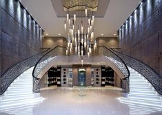 This is nice version of a modern double stairway with drop chandelier and spotters ..AJ