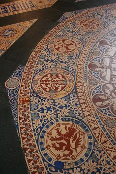 Floor tiles, Central Lobby, Houses of Parliament; from bottom to top, the rampant red lion of Scotland; the thistle of Scotland; the rose of England.
