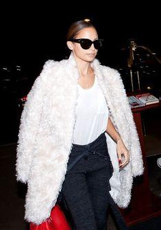 Faux fur coat and black 50's sunglasses