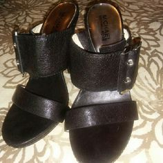 Michael Kors Heel/Sandals Black leather in great condition excepts for minors scuffs on heels as shown in pic. Michael Kors Shoes Heels