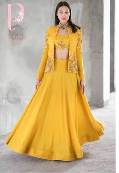 Yellow lehenga choli with a worked jacket on it n to customised more garments log on to www.prasang.in