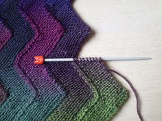 This pattern is available as a free Ravelry download Worked on just ten stitches, these garter stitch zigzag strips are joined as you go so there is no sewing up. This technique can be used to make blankets or scarves and works with any yarn and needles. The strips could also be knitted in different yarns making it a good pattern for using up oddments.