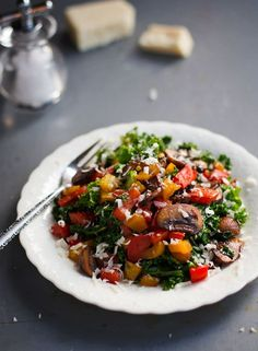 This warm balsamic kale salad has tons of flavor and includes sauteed mushrooms and peppers, bell peppers, and Asiago cheese. 200 calories per serving.