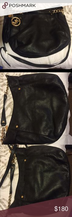 Black Michael Kors cross body purse Great purse for everyday use, black on outside and inside, short strap for shoulder or inside arm use, and longer strap to use across your body! One medium size pocket on the outside, one zipper pocket on the inside, and 3 inside slip pockets great for keys and cell phone! Purse zipper closes Michael Kors Bags Crossbody Bags