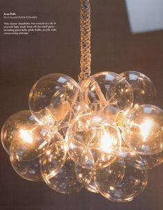 This cluster chandelier was created as a DIY light from shelf parts - glass balls, globe lights, acrylic rods, cotton string & rope.