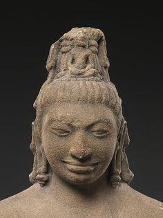 His lovely tiered locks piled on his head -jayamukta - hold an image of seated Buddha identify Bodhisattva Avalokiteshvara . 7th C. Southern Thailand