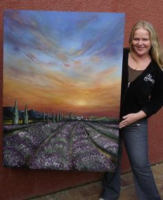 Cherie Roe Dirksen with Painting 'Lavender Field Sunset' - R13000