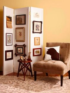 I love this idea!! Right in front our ugly heater would be a great spot! By hanging vintage pictures along a folding screen, you can change the display without adding holes to the walls. A folding screen also is a smart way to divide a room or conceal storage.