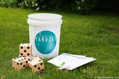 """This easy """"Yardzee"""" game will be the hit of your neighborhood! The set of wood yard dice are so simple to make, and then print off a score card and our customizable Yardzee label for an easy summer game or gift!"""