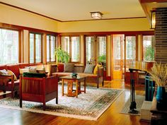 A full trim suite in clear revival of a style: Casement windows line the perimeter of the living room at eye level, framing spectacular views in true Prairie School style. Shown is an addition to a 1914 Prairie house; addition designed by John Eifler Craftsman Style Interiors, Craftsman Style Bungalow, Craftsman Decor, Craftsman Interior, Bungalow Homes, Craftsman Bungalows, Interior Trim, Craftsman Windows, Craftsman Homes