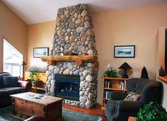 Very cozy rustic fireplace created with Coronado Stone's Creek Rock profile. Image provided by Impact Stone!