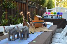 Two by two…pairs of animals and rainbow accents for a Noah's Ark party. Go to http://kidsposhparties.com to see more! #kidsposhparties #noahsarkparty
