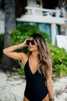 Pam Hetlinger, The Girl From Panama wearing an express black deep v high cut one-piece swimsuit, express mixed black and white print cover-up, two strap slide sandals and a Panama Hat.