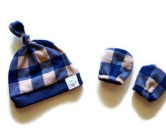 Navy and Tan Plaid Top Knot Hat and Reversible No Scratch Mittens. Baby gown in sizes 0-3 Months and 3-6 Months. Shop top knot hat, no scratch mittens, bow headband, and pacifier holders