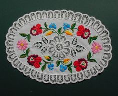 Kalocsai embroidery pattern from Hungary. Stamped fabric with machine lace details was sold at a market, I did the hand embroidery.