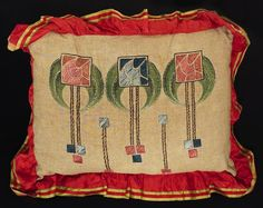 "Arts & Crafts pillow, H.E. Verran Company, Inc., Royal Society, No. 592, ca. 1911-12, red, pink, blue, green, brown and black floss with green and brown stenciling on oatmeal linen fabric, red satin or silk ribbon edge, satin and outline stitches, 20"" x 15"