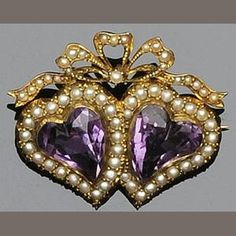 A Victorian/Edwardian gold, amethyst and seed-pearl brooch in the form of two love hearts beneath a ribbon bow. (Bonhams)