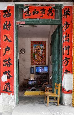Evening TV . Tachu village . Guangxi province . China