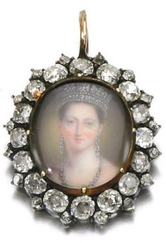 A Victorian diamond framed portrait miniature of Queen Victoria. The pendant set to the centre with a glazed oval ivory portrait miniature depicting a young Queen Victoria, framed with cushion-shaped and circular-cut diamonds, the reverse with engraved crowned VR monogram, late 19th century. #Victorian #QueenVictoria #MiniaturePortrait