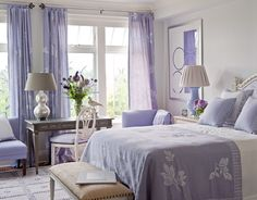 The lavender bedroom was inspired by the hydrangeas and lavender just outside the window. Curtains and pillows from JA Design Studio. Blanket from Hildreth's. Lavender lamp from Max and Company.