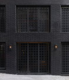 Black brick facade - interesting window treatment