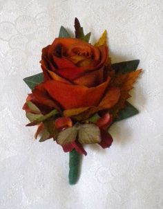 FALL Colors boutineer but with an orange rose