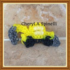 Rainbow loom charms. Construction truck with front and back bucket. Designed and loomed by Cheryl Spinelli