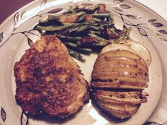 Fried pork loin chop, hassle back potatoes with roasted green beans with parmesan and bacon