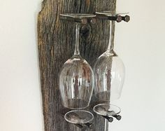 Stunning reclaimed wood wine glass rack with remarkable detail and an industrial edge. Takes any dining room or wine bar up a notch. Priced at $150, this made-to-order, wine glass rack holds six glasses and measures approximately 38l x 10w. Makes for a memorable housewarming gift, birthday present or just for yourself! Because each item is custom-made upon ordering, we are able to create glass racks that accommodate more or less glasses.