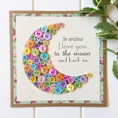 This beautifully handcrafted card was originally designed with my mum in mind. I Love you to the moon and back is something she has always said to me, and so I wanted to design and create a little tribute to her...what better way than with buttons. An eclectic mixture of buttons shaped into a moon, backed onto pretty patterned high quality paper and mounted onto a rustic Kraft card. Finished with the message Grandma I Love you to the moon and back. This beautiful, one of a kind, sentimental…