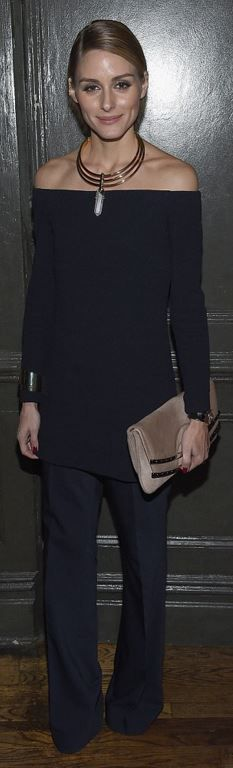Who made Olivia Palermo's gold jewelry, tan suede clutch handbag, and black off the shoulder top?